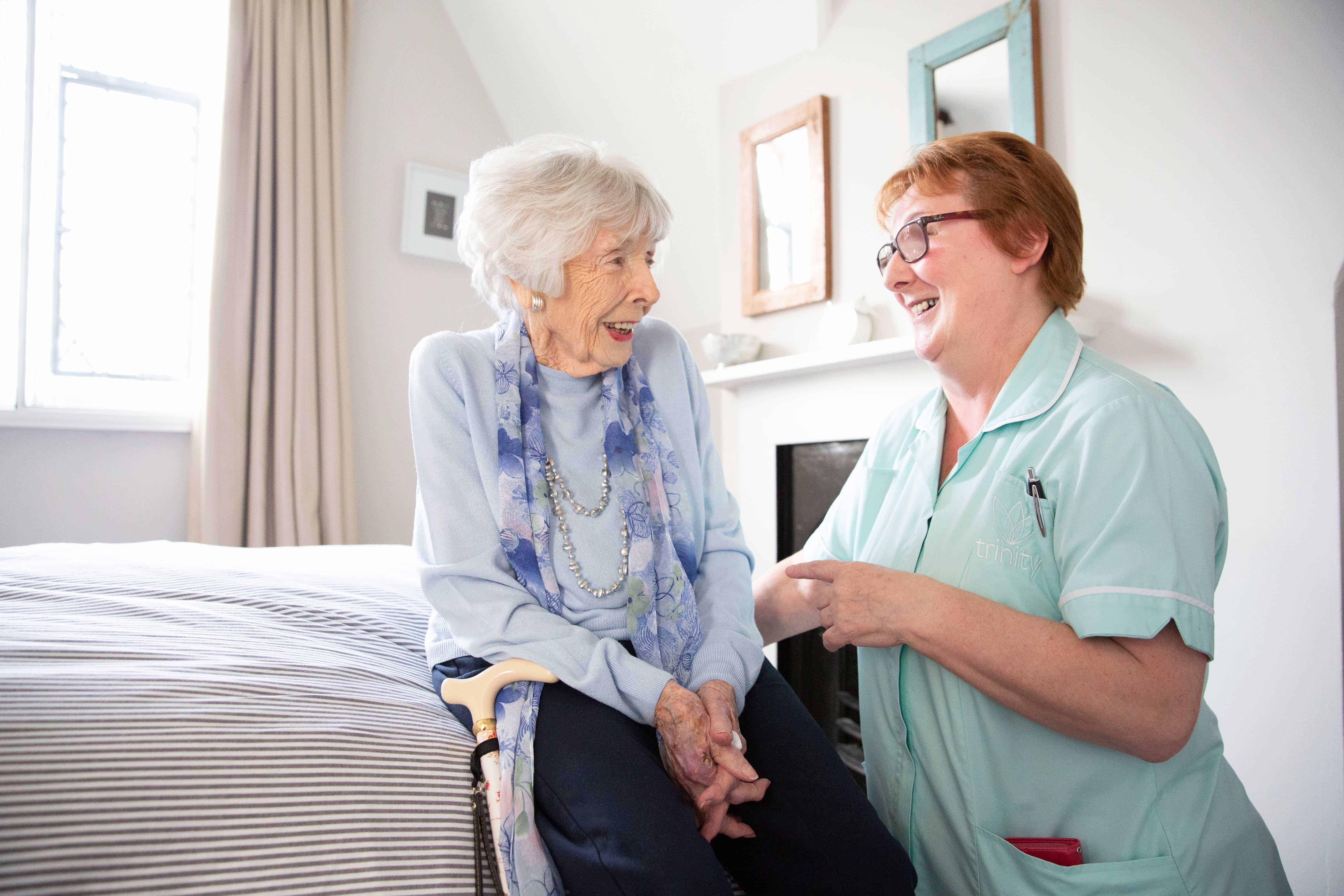 Our Trinity Carer assisting an elderly lady in the winter months