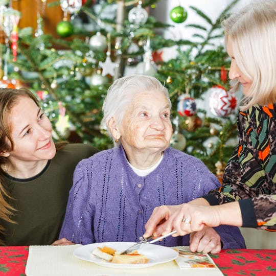 Elderly Lady with Carer at Christmas