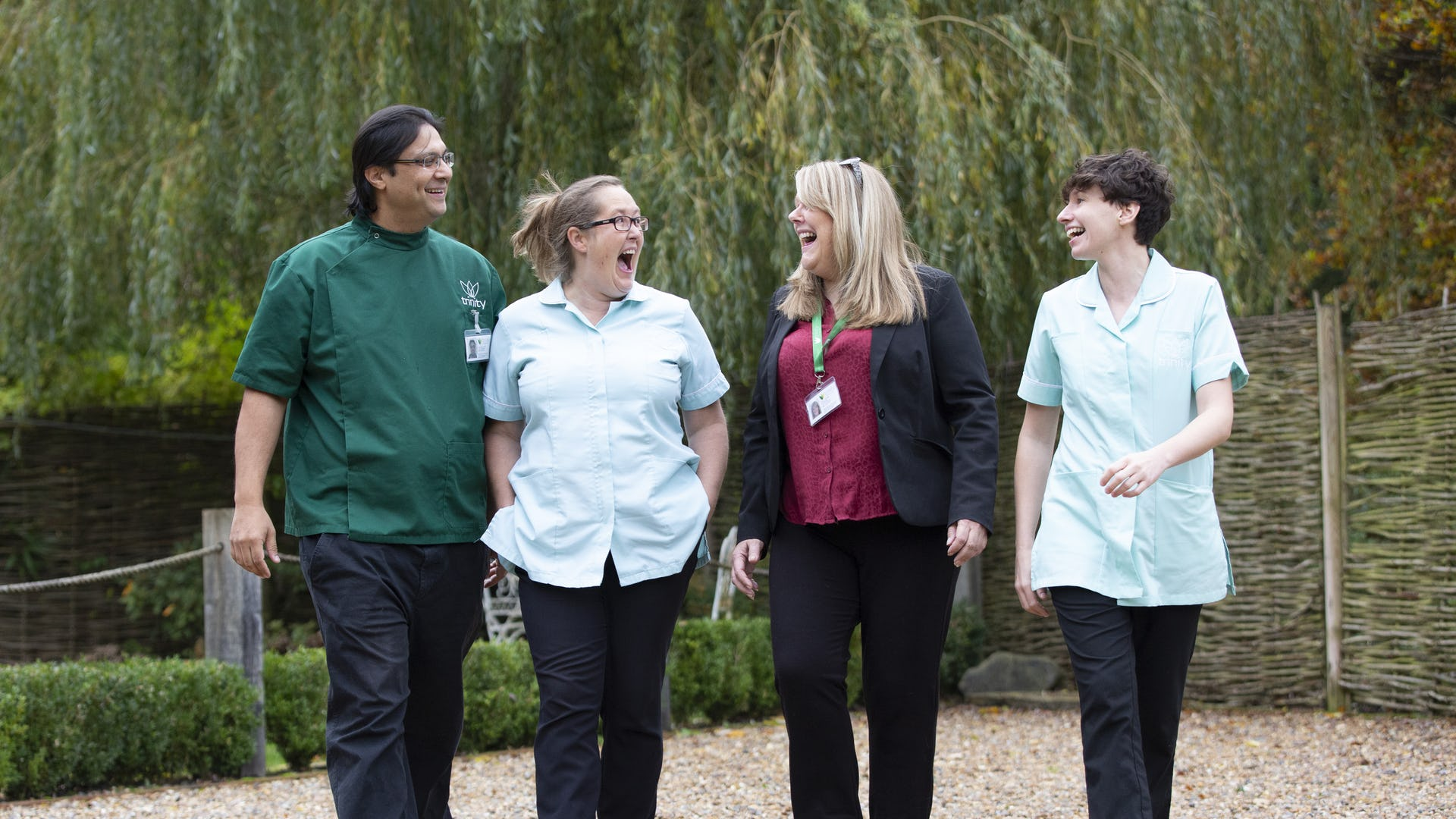 Four Trinity Homecare carers walking side by side