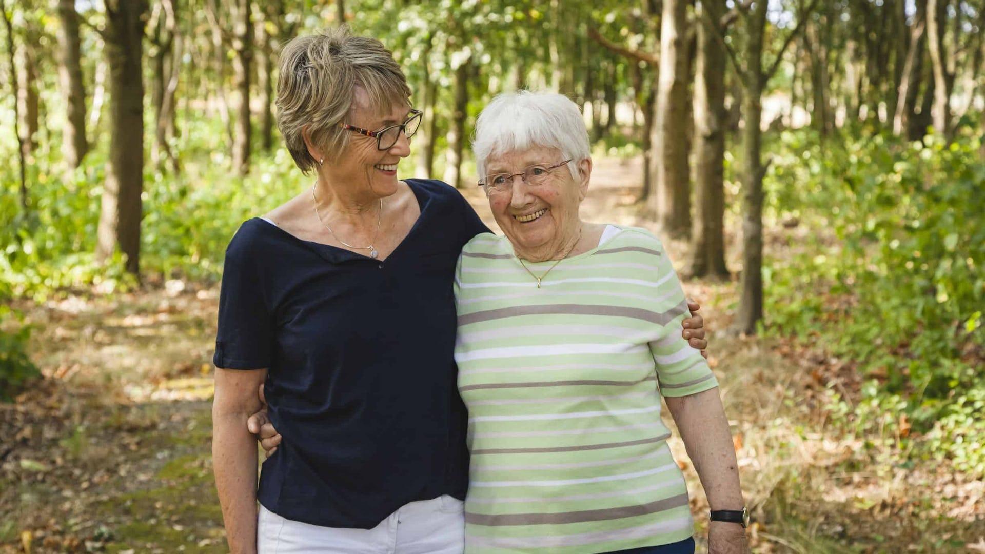 Elderly Ladies Walking In The Woods