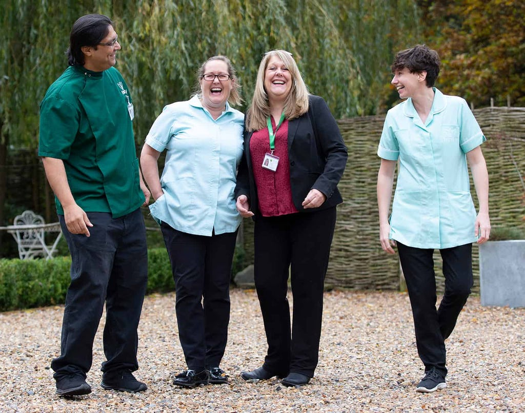 Team photo of carers and staff - Visiting Care and Live-in Care Specialists