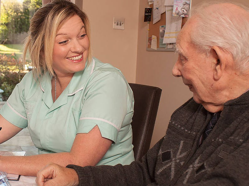 A Parkinson's patient and his carer