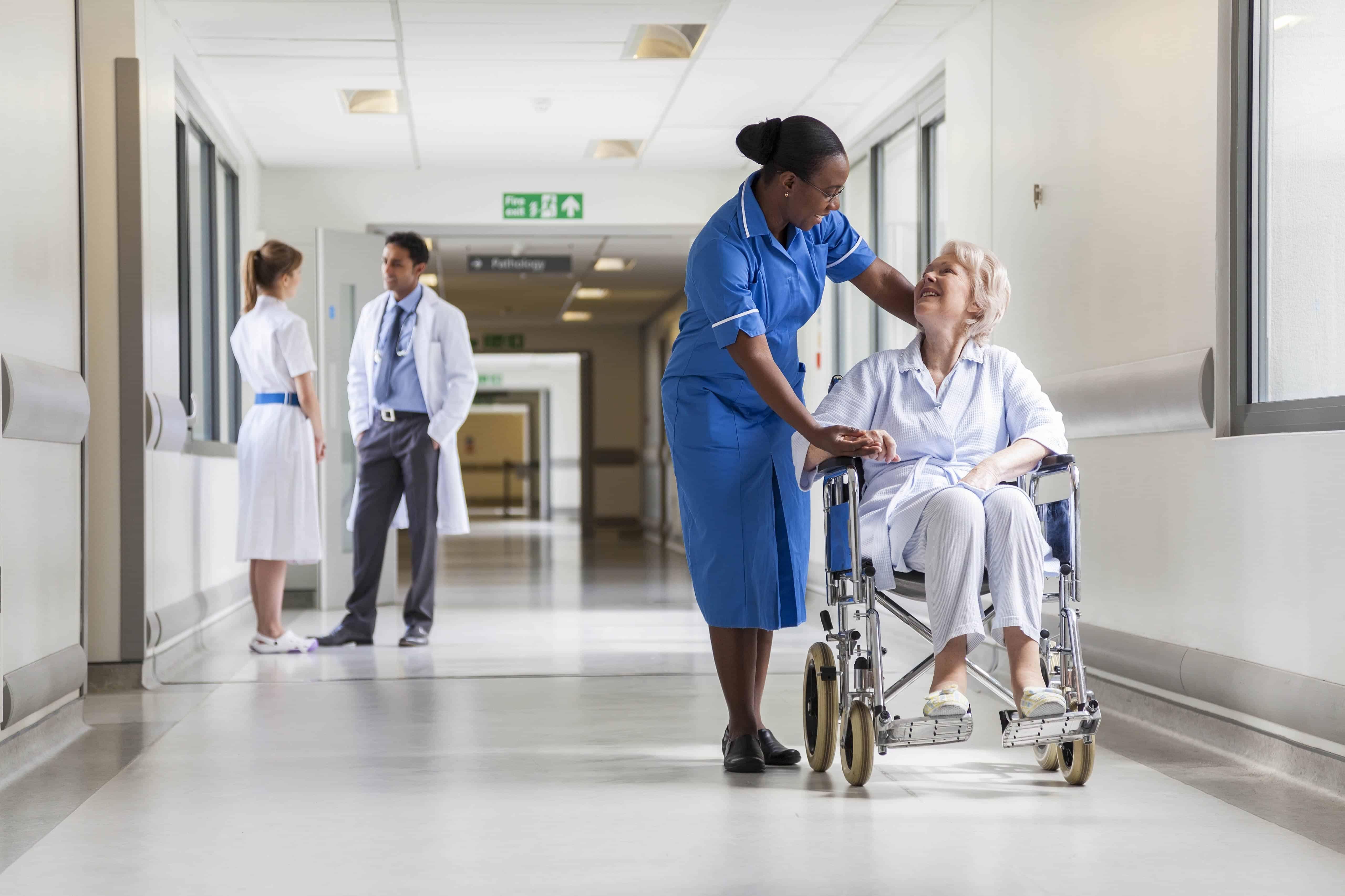 Nurse with elderly lady in a wheelchair