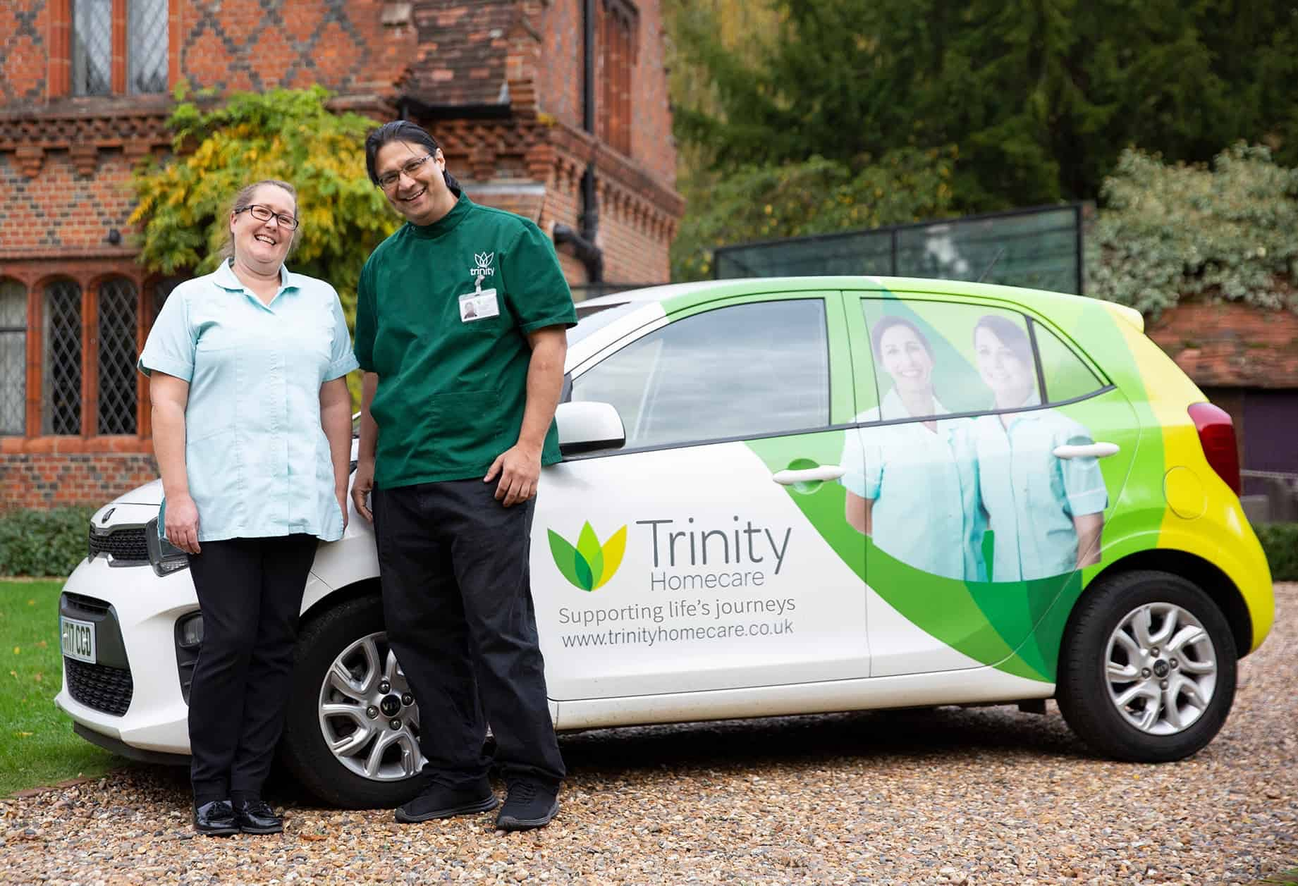 Trinity Care Staff standing next to a Trinity Homecare branded car