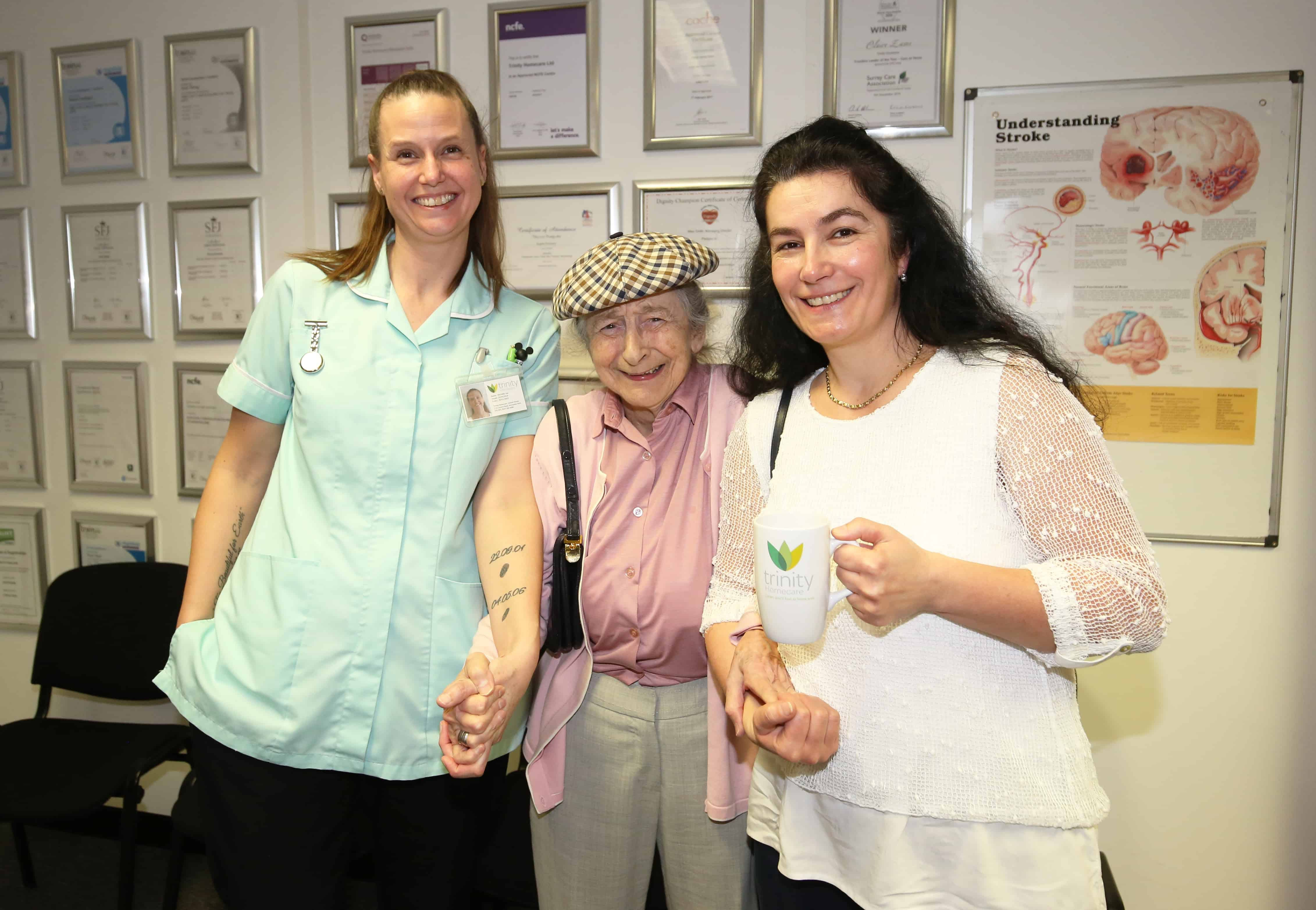 Trinity Homecare staff with a client