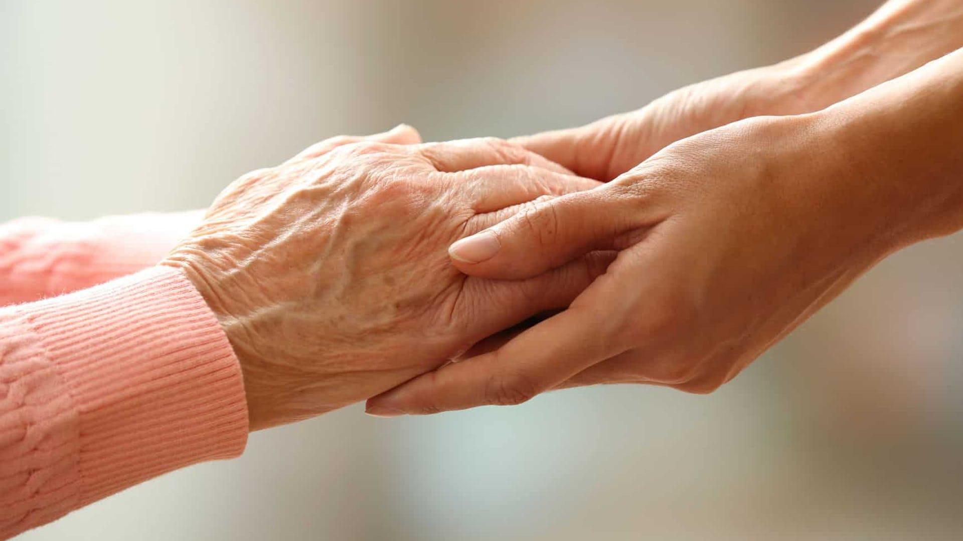 Elderly Lady and Carer Holding Hands