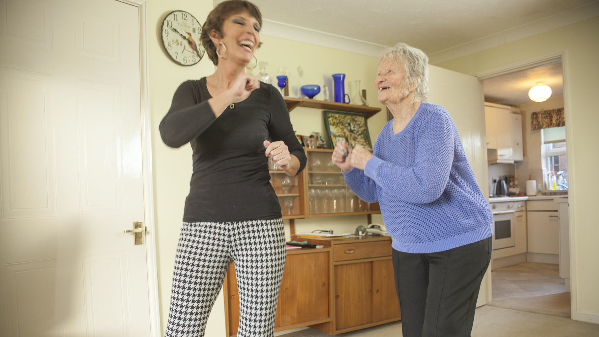 Carer and Elderly lady dancing