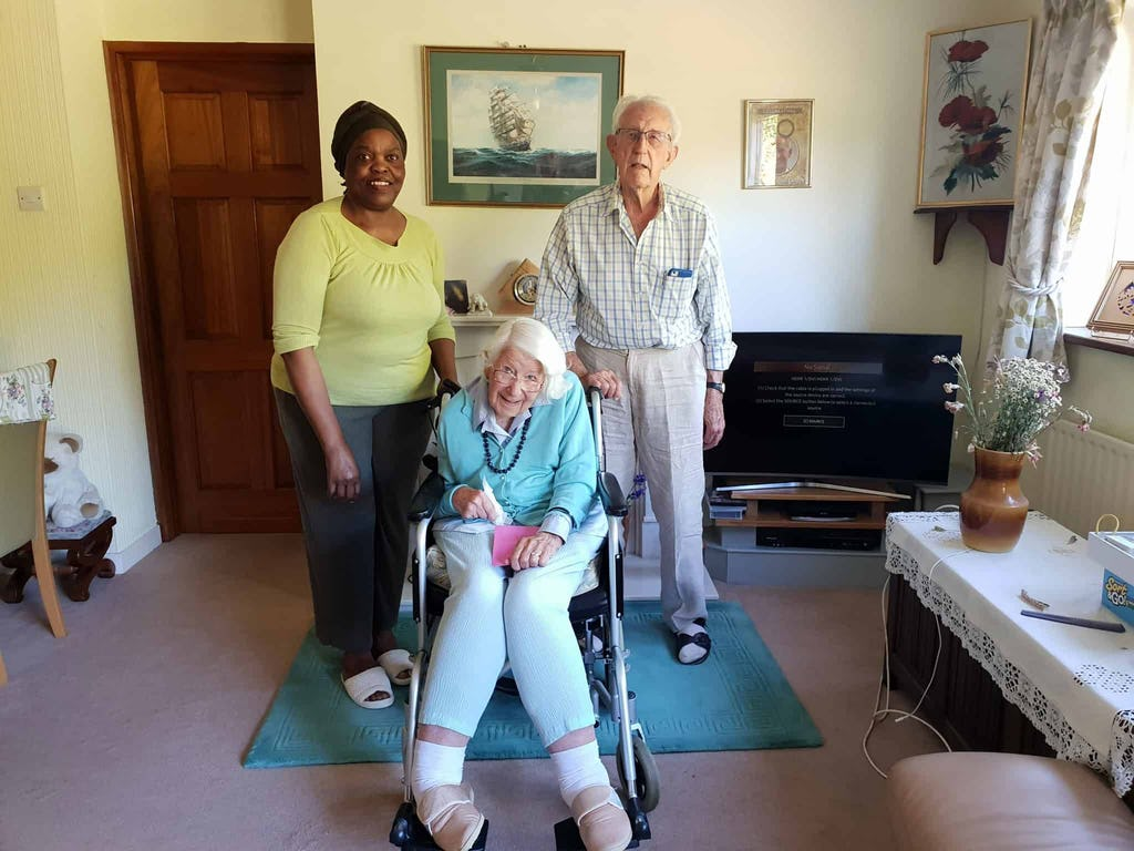 Pictured: TrinityCarer, Joana, with Pat and Dennis