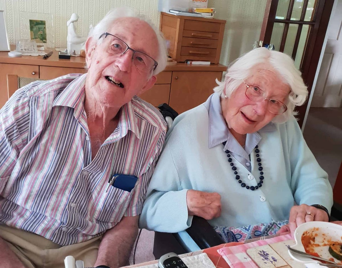Pictured: Dennis and Pat having their 70th anniversary dinner date at home