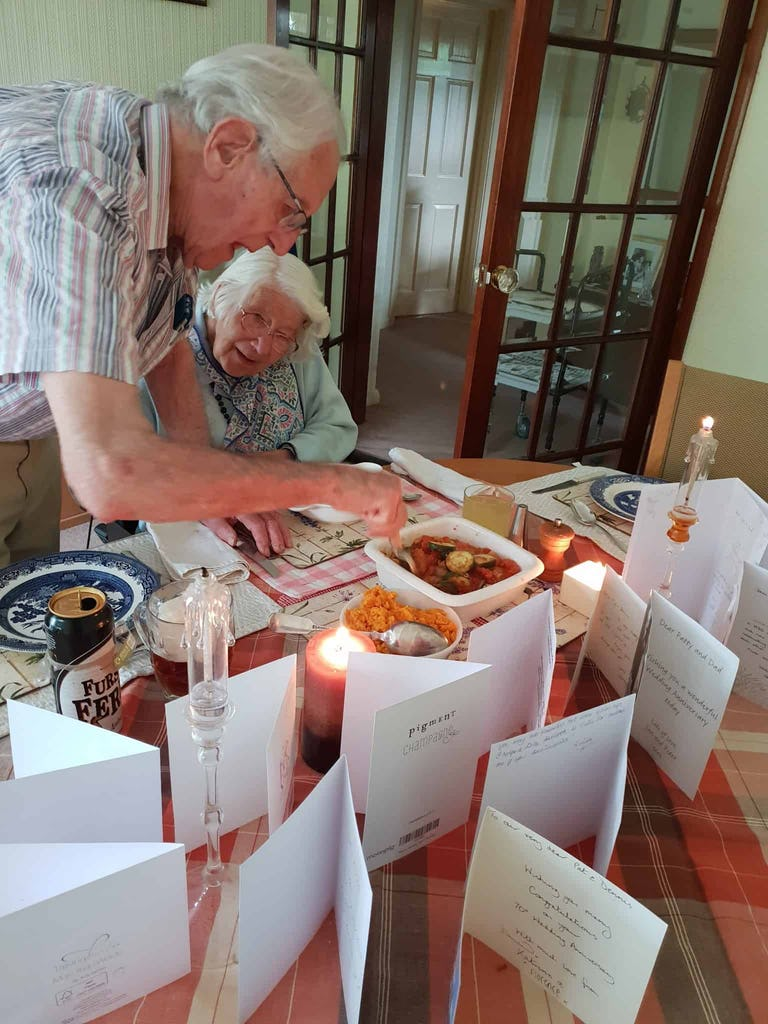Pictured: Dennis serving dinner by candlelight for Pat on their 70th anniversary